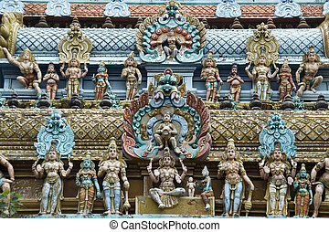 Figurines on Temple Tower - Colorful figurines on tower of...