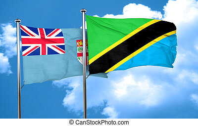 Fiji flag with Tanzania flag, 3D rendering