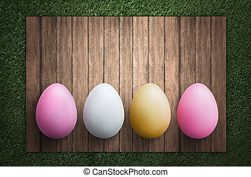 fila, de, huevos de pascua, en, tabla de madera