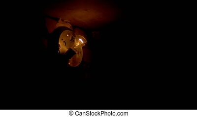 Filament Bulb Lights Off on a Stone Wall - Incandescent Lamp...