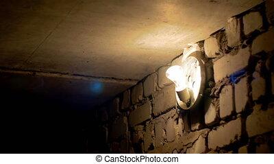 Filament Bulb Lights Off on a Stone Wall