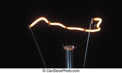 filament lamp - filament light bulb is dissolved in the...