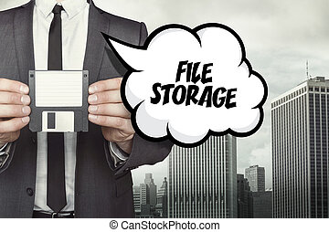 File storage text on speech bubble with businessman holding diskette