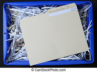file with business contracts in blue recycling bin