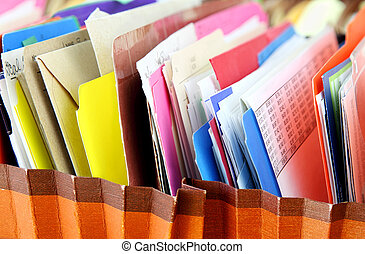 Files - Row of folders in expending file pockets