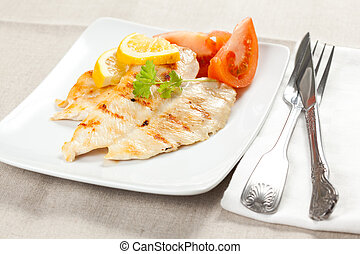 filet grilled chicken with tomato and parsley
