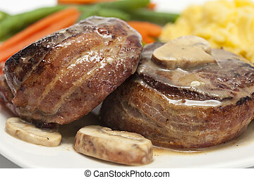 Filet Mignon served with vegetables - Filet Mignon...