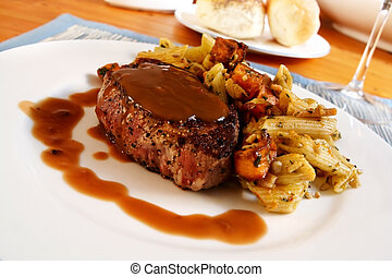 Filet Mignon - Rare filet mignon in a pepper sauce, with a...