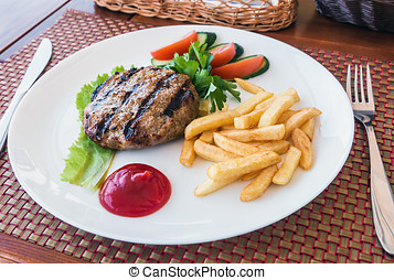 filet of beef grilled with French fries