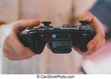 filho jogando, jogos computador, com, um, joystick.