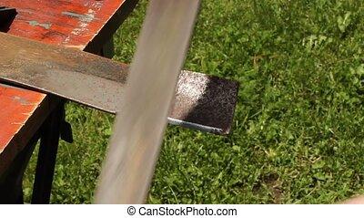 filing a mower blade