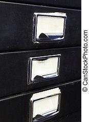Filing cabinet #3 - Close-up of a black mini filing cabinet...