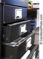 Filing cabinet #4 - Close-up of a black mini filing cabinet ...