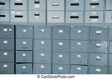 Filing cabinets - Wall of old gray metal filing cabinets...