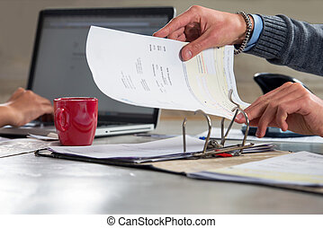 Filing invoices and documents in a ring binder - People,...