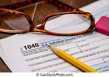 Filing Taxes and Tax Forms - Close up of tax form 1040 with...