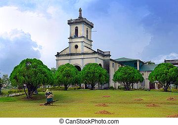 Filipino village scene with church.