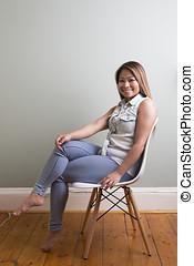 Filipino woman on grey background