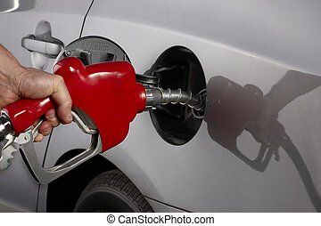 Fill \'er up! - Gas attendant fills car with gasoline