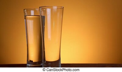 Fill the glass with water isolated on yellow background