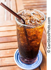 Filled glass with fresh ice cola drink
