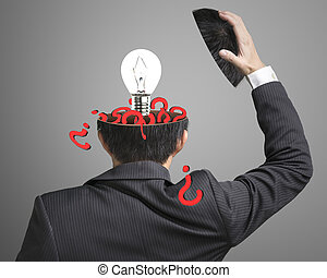 Filled out question inside businessman head with lamp pop out on gray background
