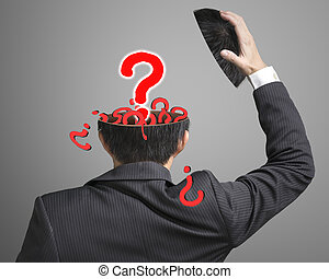 Filled out question inside businessman head with pop out big one in gray background