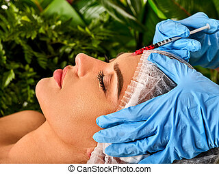 Filler injection for forehead face. Plastic aesthetic facial surgery.