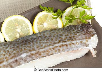 Fresh cod fillet with fresh lemon slices