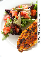 Whole season fillet of white fish on mixed salad with tomatoes