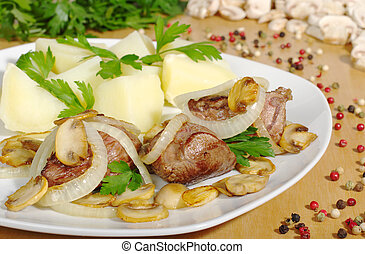 Fillet with mushrooms, onions and potatoes with ingredients in the background