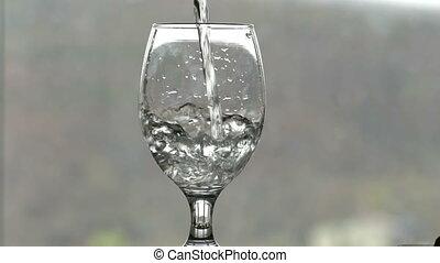 filling a glass of liquid