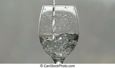 filling a glass of sparkling water