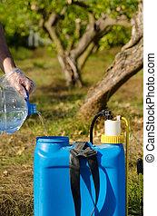 Filling a pesticide sprayer