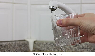Filling glass of water