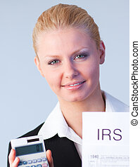 Business woman looking at filling in tax returns