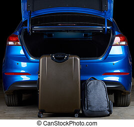 Filling modern car trunk with bags