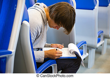 Filling out an itinerary in a train