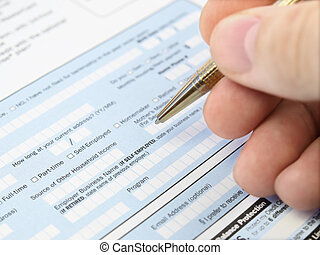 Filling out application form. - Man filling out application...