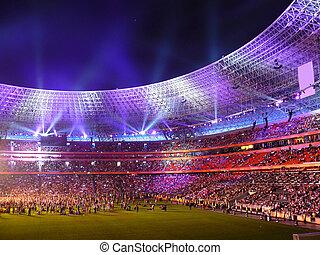 Beautiful night football stadium and light rays