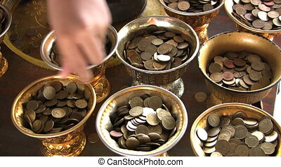Filling Temple Containers With Coin