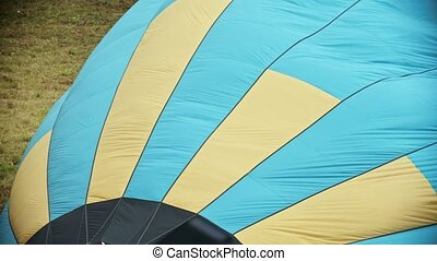 Filling the air balloon with hot air using fire machine -...