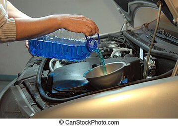 Filling the windshield washer fluid on a Car
