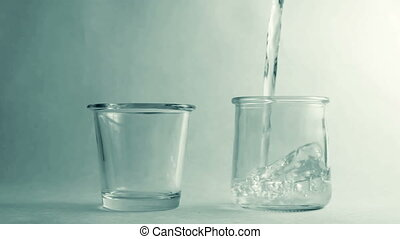 Filling two different glasses of wa
