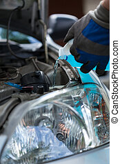 Filling windshield washer fluid - Close-up of a filling ...