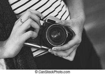 Film camera in the hands of the girl