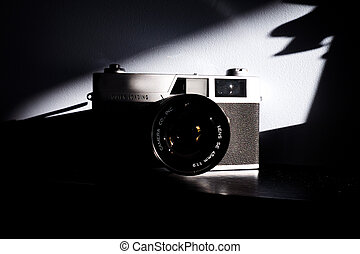 film camera with shadows on the wall