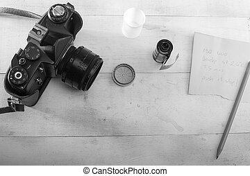 35 mm film camera and film with development notes