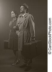 Film noir: elegant couple leaving in the dark