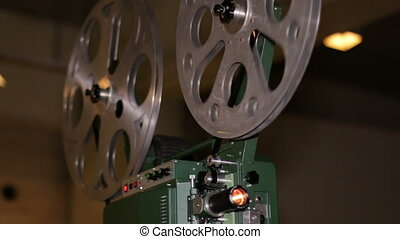Film Projector Projecting 16mm Film - A technician projects...